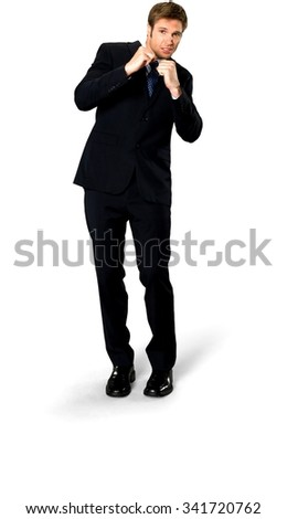 Scared Caucasian man with short medium blond hair in business formal outfit being in boxing stance - Isolated