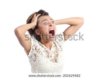 Scared crazy woman crying with hands on head isolated on a white background  - stock photo
