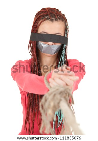 scared kidnapped young woman, hostage, white background - stock photo