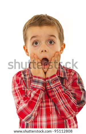 Scared litle kid boy holding hands on face and screaming isolated on white background - stock photo