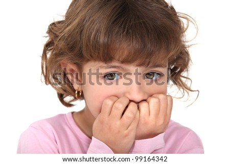 Scared little girl biting nails - stock photo