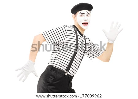 Scared male mime artist running away isolated against white background - stock photo