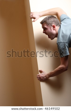 Scared Man Looking Around Corner and Screaming - stock photo