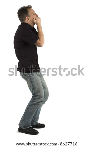Scared man looking up, against a white background - stock photo