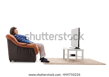 Scared man watching a horror movie on TV seated in an armchair isolated on white background - stock photo