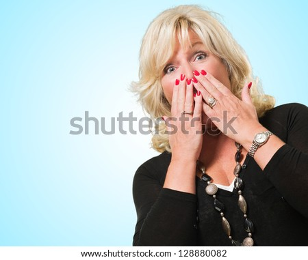 Scared Woman Covering Her Mouth against a blue background - stock photo