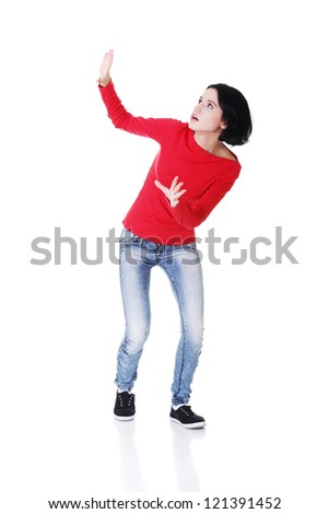 Scared woman defending herself, isolated on white background - stock photo