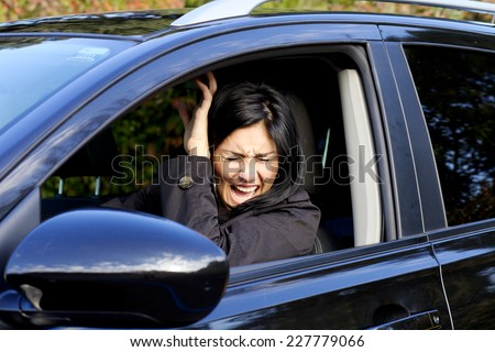 Scared woman not able to prevent car accident - stock photo