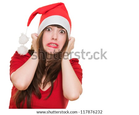 scared woman wearing a christmas hat against a white background - stock photo