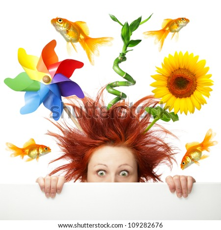 Scared woman with different object growing out of her head - stock photo