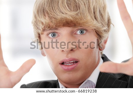 Scared young businessman - stock photo