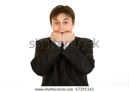Scared young businessman holding hands near  mouth isolated on white - stock photo