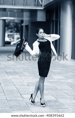 Scared young businesswoman  - stock photo