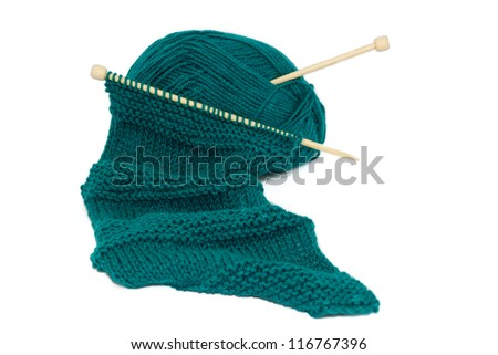 Scarf on knitting needles using two different stitches with a ball of wool - stock photo
