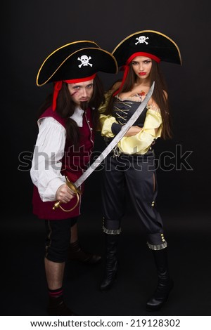 Scarface pirate with a sword and girl pirate