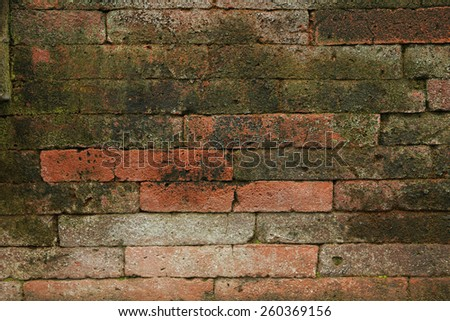Scarred brick wall background. - stock photo