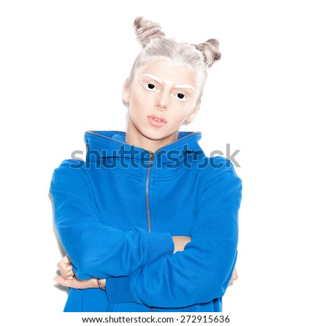 Scary evil young woman with black eyes for a fear or Halloween concept. Beauty girl with bright makeup hairstyle with horns in a blue hoodie having fun. Not isolated on a white background