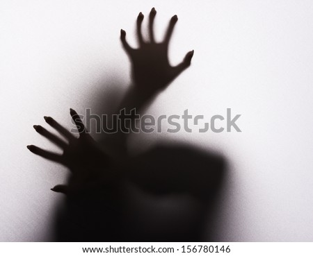 Scary female silhouette on the fabric. - stock photo
