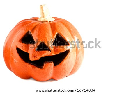 Scary glowing Halloween pumpkin against white background.