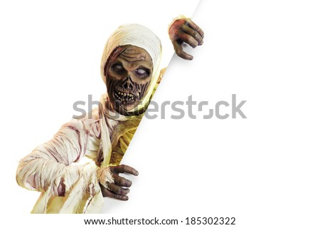 Scary Halloween mummy holding a sign isolated on white - stock photo