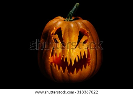 Scary Halloween pumpkin, isolated on black - stock photo