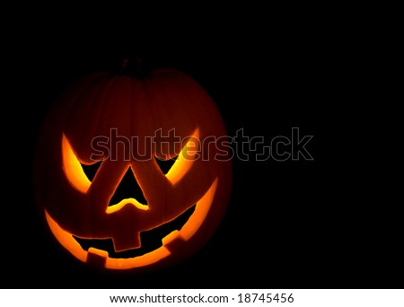 Scary Halloween pumpkin on black - stock photo