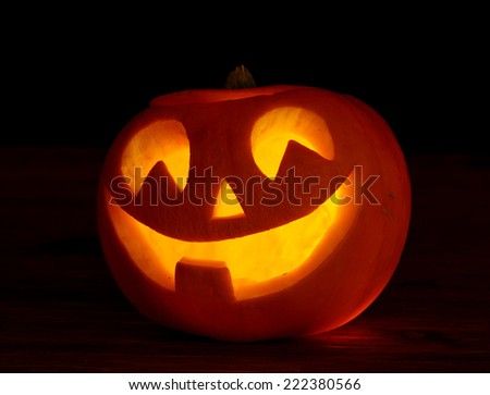 Scary halloween pumpkins  jack-o-lantern on black background - stock photo