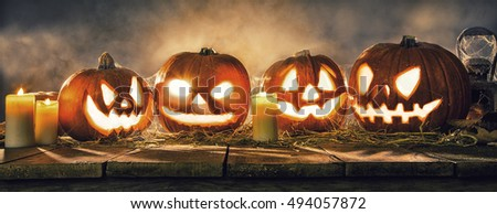 Scary halloween pumpkins on wooden planks. Empty space for text