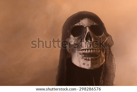 Scary halloween skull on a smoky background - stock photo