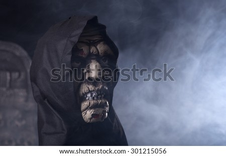 Scary halloween zombie prop on a smoky background - stock photo