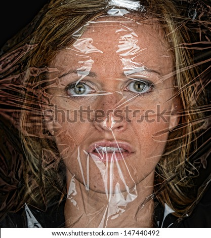 Scary Image of a woman Under plastic wrap - stock photo