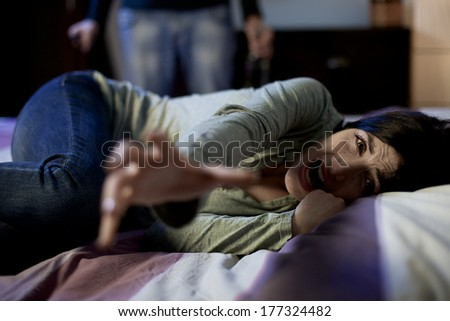 Scary life of young woman abused and domestic violence - stock photo
