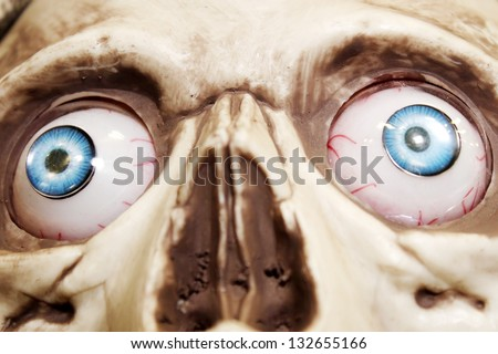 Scary skeleton with spooky eyes - stock photo
