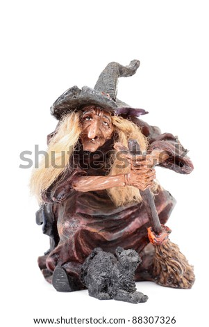 Scary witch and black cat isolated on white background - stock photo