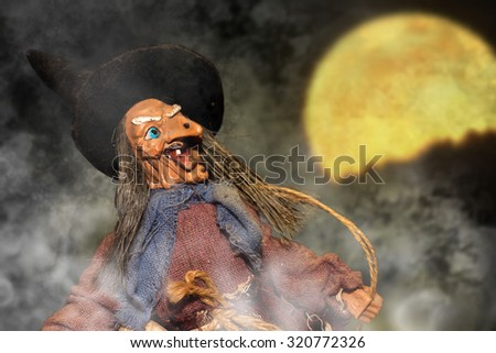 scary witch doll figurine hat - stock photo