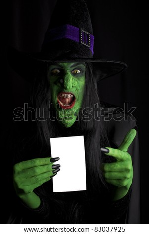 Scary witch with space for text, black background. - stock photo