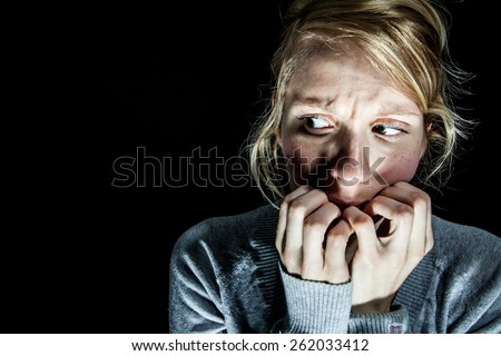 Scary Woman Afraid of something in the Dark - stock photo