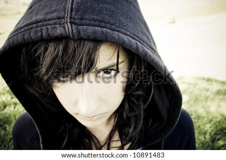 Scary young woman staring at camera. - stock photo