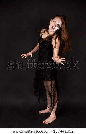 Scary zombie woman in black dress - stock photo