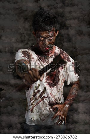 Scary zombies with an ax - stock photo