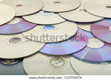 scattered cd's or dvd's - stock photo