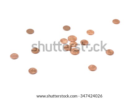 Scattered coins on white table - stock photo