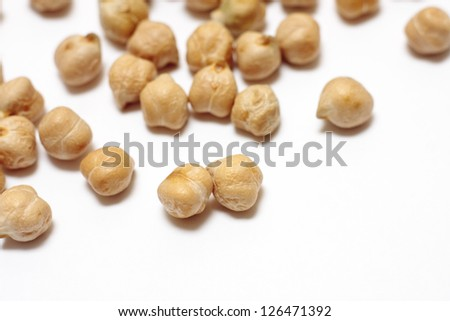 Scattered dried chickpeas - stock photo