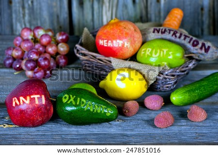 scattered fruits and vegetables with cut words - healthy lifestyle concept