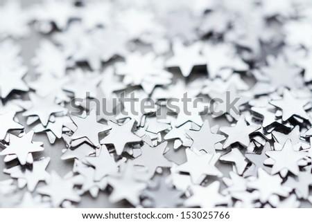 Scattered glittering stars confetti - stock photo