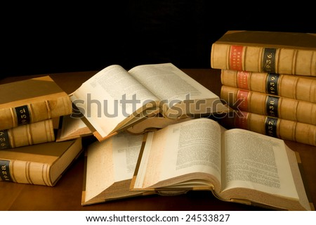 Scattered law books being used for research. - stock photo