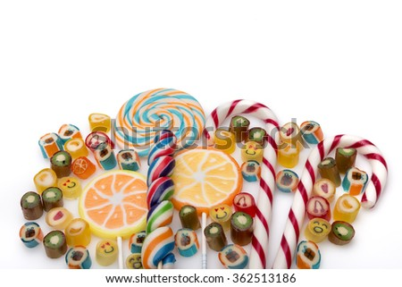 scattered on a white background candies