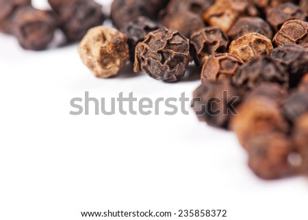 Scattered peppercorns isolated on white background