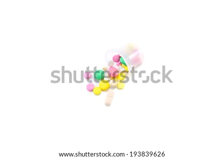 scattered pills on white background - stock photo