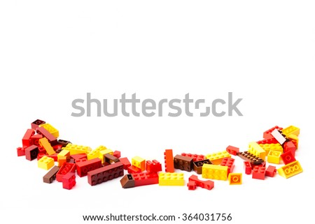 Scattered plastic toy blocks on white background - stock photo